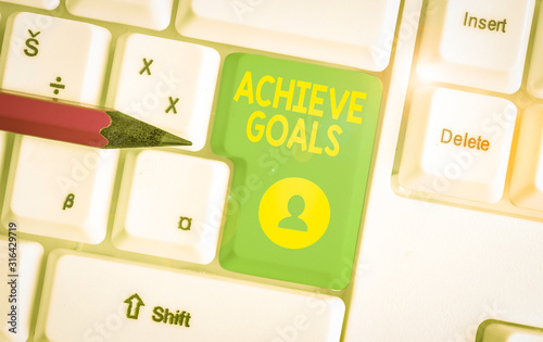 Photo Writing note showing Achieve Goals