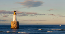Lighthouse At Sunset With Floc...