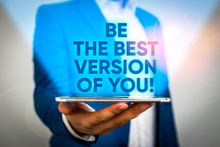 Writing Note Showing Be The Best Version Of You. Business Concept For Going To Move Away From Where Are Start Improving Man In The Blue Suite And White Shirt Holds Mobile Phone In The Hand
