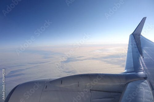 flight above the clouds, aerial view from plane - 316442118