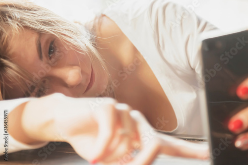 Close up psychological portrait of sad and depresseed beautiful woman with smart phone after a quarrel Canvas Print