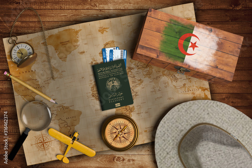 Top view of traveling gadgets, vintage map, magnify glass, hat and airplane model on the wood table background Canvas Print
