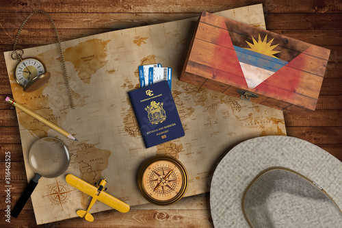 Top view of traveling gadgets, vintage map, magnify glass, hat and airplane model on the wood table background Wallpaper Mural
