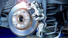 Closeup Car Disk Brake Maintenance Service In Car Garage And Copy Spcae