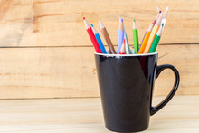 Color Pencils In Pen Holder On...