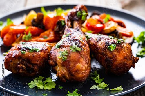 Barbecue chicken drumsticks with roast vegetables Canvas Print
