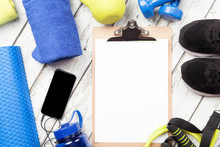 Smart Phone, Clip Board And Exercise Equipment