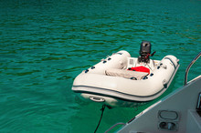 Rubber  Dinghy  On The Emerald Green Sea
