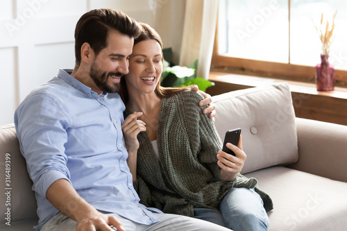 Smiling millennial couple make self-portrait picture on cellphone Slika na platnu