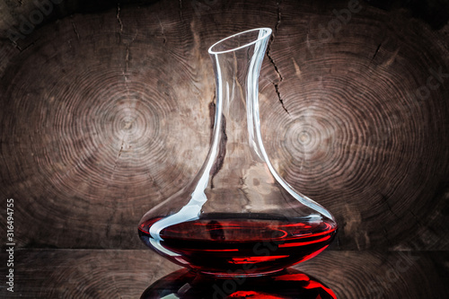 classic decanter with red wine on wooden background Wallpaper Mural