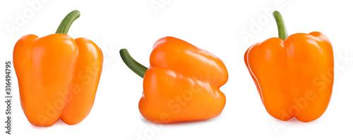 Fototapeta Set of ripe orange bell peppers on white background obraz
