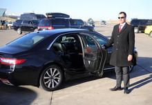 Chauffeur Opens Car's Rear Door