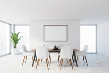 Minimalistic White Dining Room With Poster