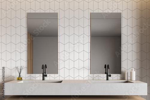 Fotografía White tile bathroom interior with double sink