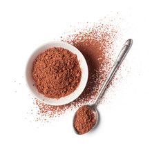 Cocoa Powder In White Bowl With Silver Spoon