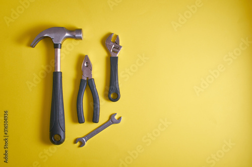 Fotomural A set of tools, a hammer, pliers, wrenches, on a yellow background