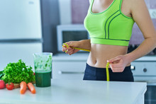 Diet Woman With A Green Smoothie For Losing Weight. Vegetables Detox Organic Fitness Drinks For Healthy Eating