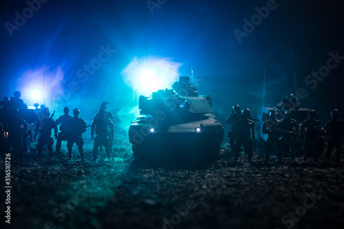 Fototapeta  Military patrol car on sunset background