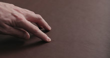 Man Hand Shows Scar On Brown Leather Piece Closeup
