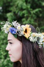 Close Up Portrait Of Girl Wearing Flower Crown In Nature Sunflowers