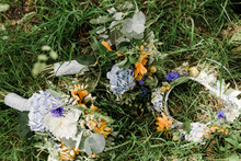 Bouquet And Flower Crown Laying In The Green Grass Hippie Summer