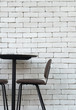 Leinwanddruck Bild - black brown chair and table with white brick indoor background