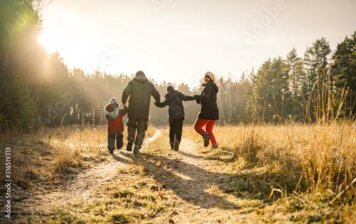 Fototapeta happy family walking on country road