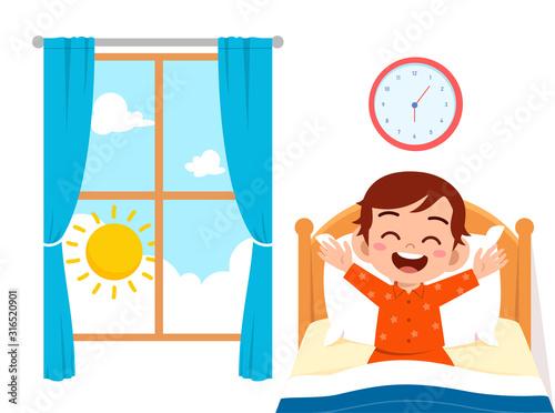 Fotomural happy cute little kid boy wake up