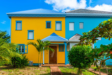 Colorful Houses In Orient Bay On The Island Of Saint-Martin In The Caribbean
