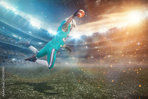 A football player leaping off the ground, to catch the ball near the goal posts Canvas Print