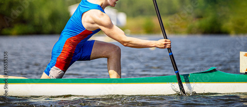 Fototapeta close up athlete canoeist rowing canoeing competition race