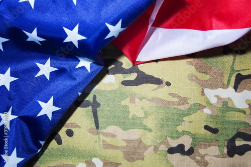 American flag and camouflage. Military background. Copyspace Wallpaper Mural