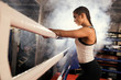 canvas print picture - exhausted after fight boxer woman in white top stand in ring, active and sportive female brunette in smoky ring. combate readiness and self-defense