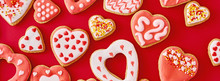 Background Of Decorated With Icing And Glazed Heart Shape Cookies On The Red Background, Long Banner. Valentines Day Food Concept