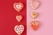 Decorated Heart Shape Cookies On A Colored Red And Pink Background, Top View