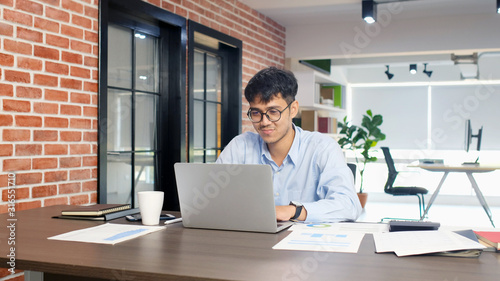 Fototapeta Young asian businessman concentrate on working with laptop computer at office, Asian office man comtemplate on working with laptop computer  business people and office lifestyle concept obraz