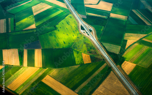 Fototapeta aerial photo from a plane, top view, road through the fields obraz