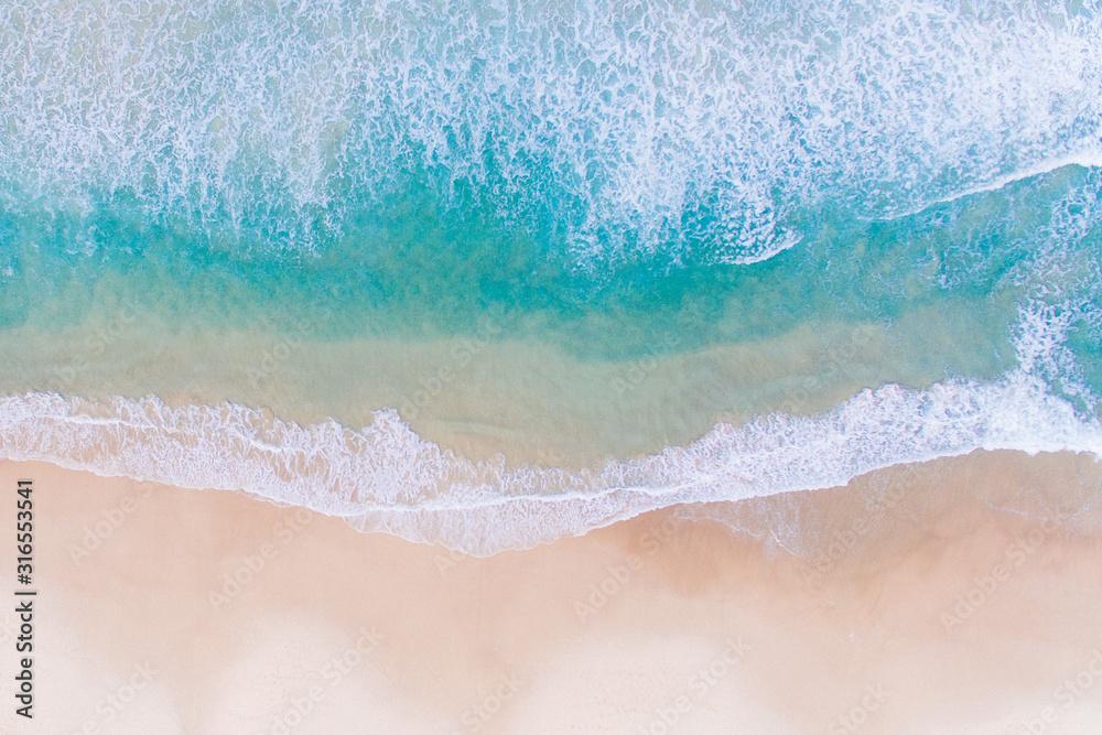Fototapeta Wave of the sea on the sand beach