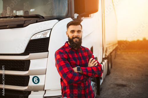 Fotografiet Truck driver preparing for the next destination