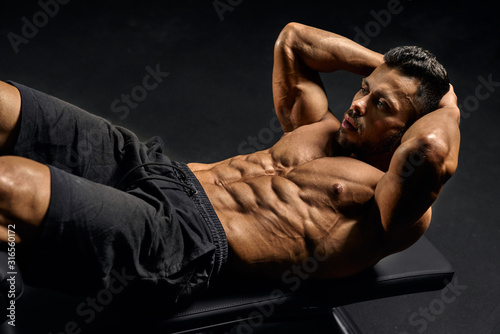 Man training abs on mat. Canvas Print