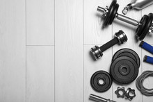 Gym Equipment On Wooden Floor, Flat Lay. Space For Text