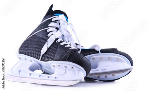 Photo Pair of ice hockey skates isolated on white