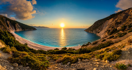 Beautiful summer sunset on Mirtos beach in Greece - panorama