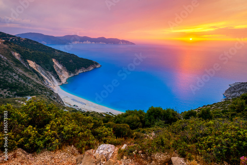 Beautiful summer sunset on Mirtos beach in Greece Wallpaper Mural