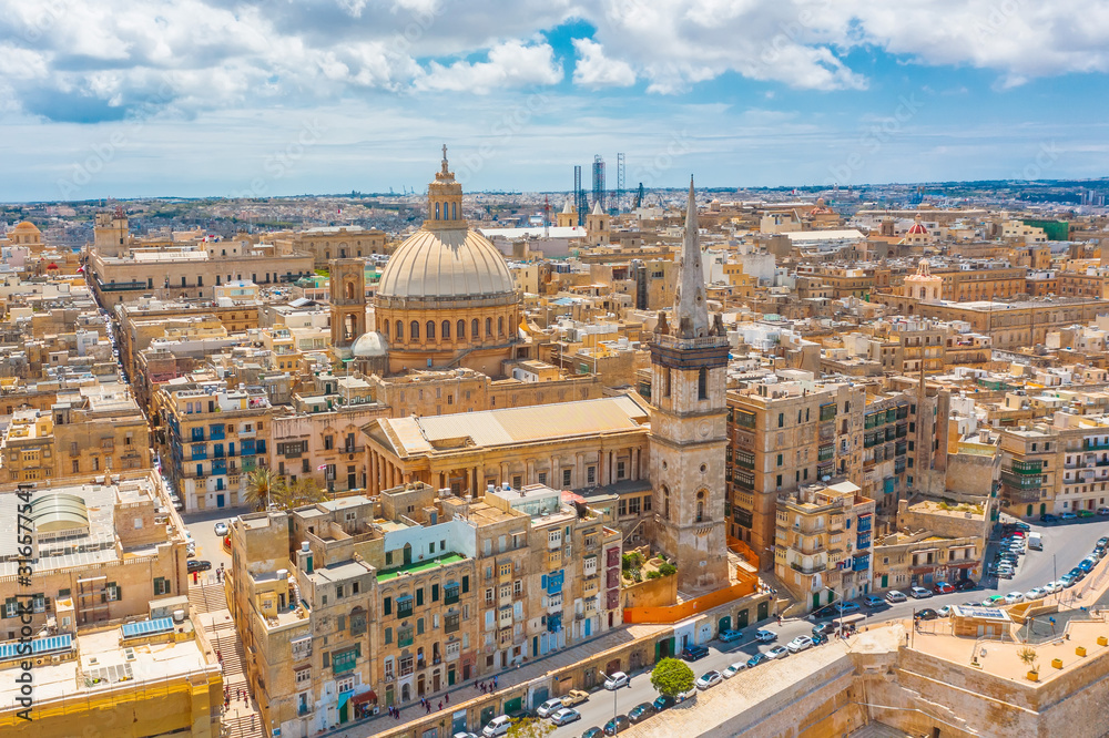 Fototapeta View of Lady of Mount Carmel church, St.Paul's Cathedral in Valletta city center, Malta.