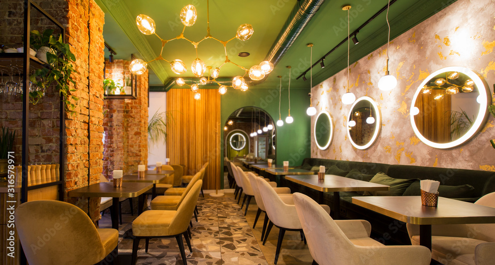 Fototapeta Light modern interior of urban restaurant or cafe with dining places