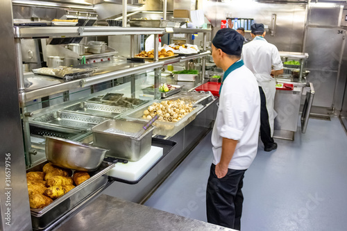 Kitchen crew work in the galley of a cruise ship in the Caribbean Sea Fototapeta