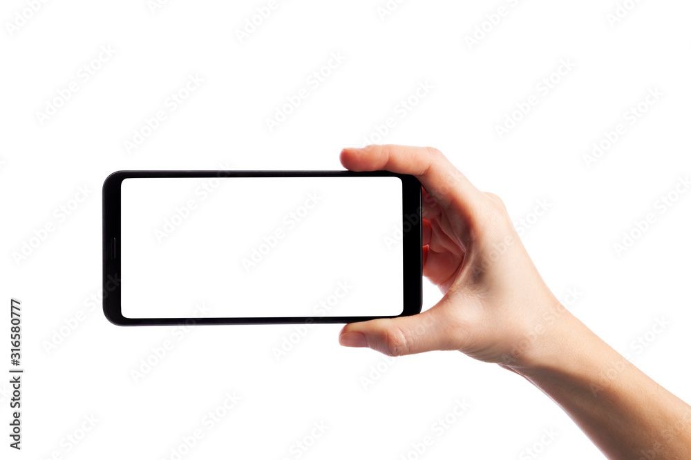 Fototapeta Woman holding smartphone with empty screen isolated on white background. Female hand with phone, space for text
