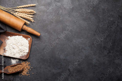 Obraz Various bread ingredients. Wheat, flour and cooking utensils - fototapety do salonu