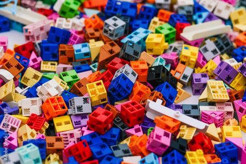 Fototapeta Designer details are colored. Small square blocks of a board game. Development of imagination and logic in a child in kindergarten or school obraz